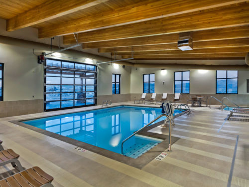The indoor pool with garage door at our Lander WY accommodations