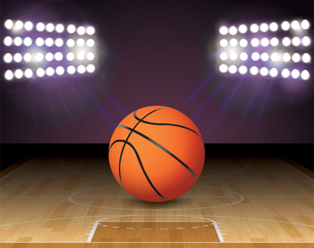 basketball on court with lights